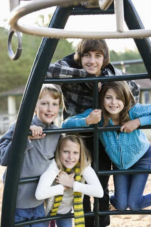Group of children (10 to 15 years) posing together on playground Stock Photo - 8167714