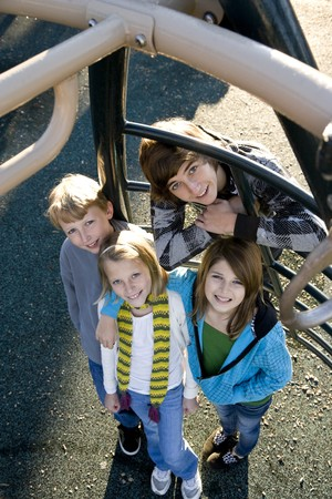 Group of children (10 to 15 years) standing together on playground equipment Stock Photo - 8167727