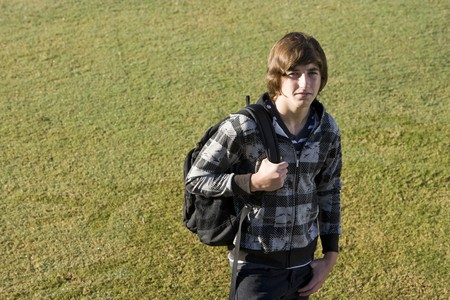 Teenage student (15 years) carrying bookbag on shoulder, with serious expression Stock Photo - 8167719