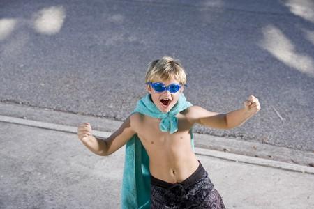Boy, 9 years, with pretend superhero costume