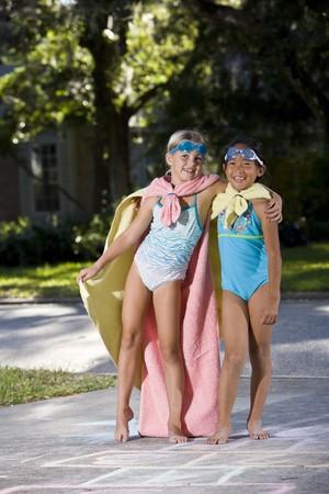 Two girls, 7 years, pretending to be superheroes photo