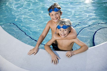 Portrait of happy boys at swimming pool photo