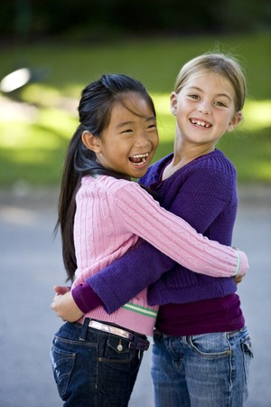 sweater girl: Two girls, 7 years, happy together