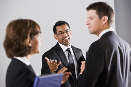 African American businessman, 40, talking with two colleagues photo
