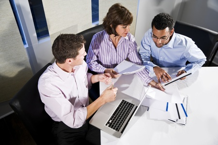 Workplace diversity - multiracial businesspeople working together in boardroom Stock Photo - 8338189