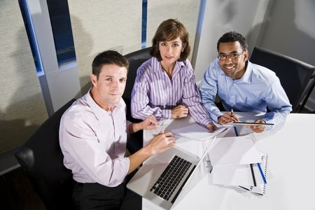 Workplace diversity - multiracial businesspeople working together in boardroom photo