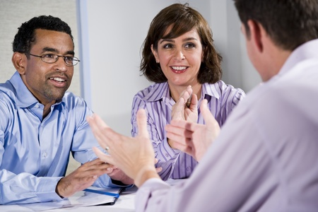 discussion group: Multiracial business meeting in boardroom, sitting at a table Stock Photo