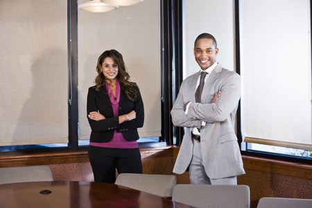 African American businessman and Indian businesswoman meeting in office boardroom photo