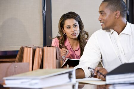 African American businessman and Indian businesswoman working together in office, focus on woman Stock Photo - 8554802