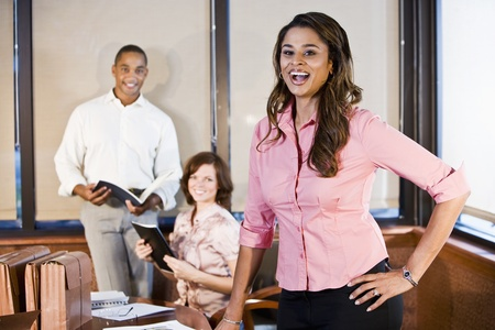 Indian businesswoman working in office with multiracial coworkers, focus on foreground Stock Photo - 8554807