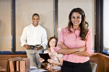 Indian businesswoman working in office with multiracial coworkers, focus on foreground Stock Photo - 8554810