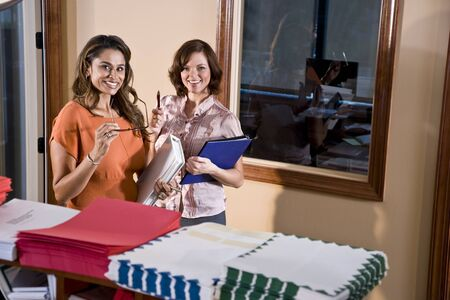 Multiethnic office workers standing in mailroom Stock Photo