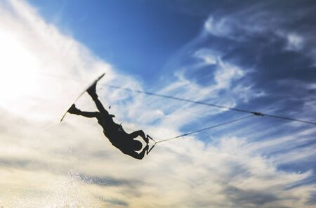 wakeboarding: extreme wakeboarding on water with beautiful sky background Stock Photo