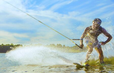 wakeboarding: wakeboarder trains on the lake in Belarus