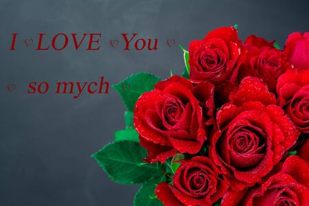 red roses on black background and text