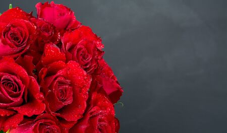 black background and red roses
