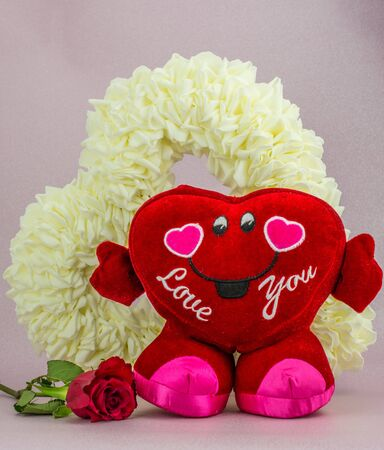 Big red heart with red roses and white heart