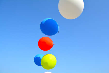 happy birth day: Unfiltered, with natural lighting, multicolor balloons on blue sky, happy birth day in summer and wedding honeymoon decoration. Stock Photo