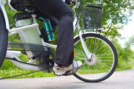Riding e-bike or electric bicycle, shot from below, ecology concept