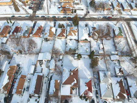 Snow view from the top with urban city, aerial photography over the suburb. Winter scenery of the american city from the bird eye.