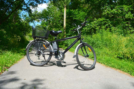 Electric bicycle in the Canadian park in sunny summer day. Unfiltered, with natural lighting