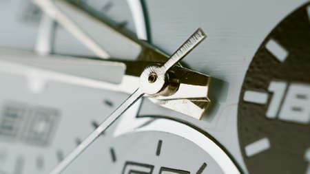 Macro shot of clock face with seconds arrow. Fast flow of time concept. Real watch shot with macro lens close-up view.
