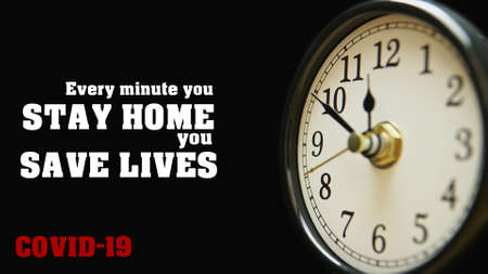 Every minute you stay home you save lives. Covid-19 pandemic quote for self isolation and quarantine concept with slogan clock face dial. Time is valuable for prevention Coronavirus spread. Stok Fotoğraf