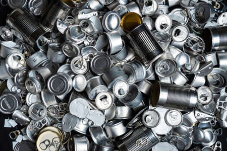 Recycle empty cans and tin for food and drink. Aluminum soda cans and food jars. Sorted metal trash and garbage ready for recycling. Steel rubbish. Zero waste and no pollution.