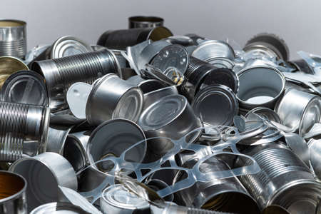 Large amount of metal tins, cans and jars for recycling. Aluminum metal food and drink sorted scraps. Steel packaging. Zero waste and recycle of domestic waste at home concept. No pollution.