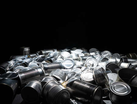 Recycle empty cans and tin. Aluminum soda cans and food jars. Sorted metal trash and garbage ready for recycling. Steel rubbish. Concept of environmental catastrophic apocalypse garbage pollution.