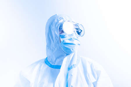 Portrait of female nurse, medical scientist wearing white ppe suit, hospital protective scrabs glasses goggles, shield and face mask. Coronavirus pandemic Covid-19. Vaccination in medical clinic.