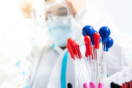 Close up of scientist or doctor table with medical lab tools or pipettes, blood tubes. Covid 19 research concept. Vaccine side effects and allergic reaction research and discoveries. Stockfoto