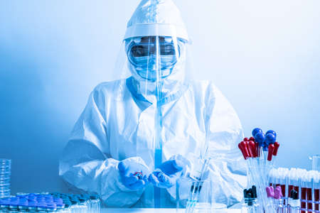 Different Covid 19 vaccines presented by laboratory scientist nurse. Various coronavirus vaccine choice. Pandemic prevention and immunization. Doctor in ppe shows vaccination research.
