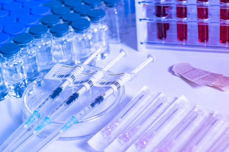 Focus on Coronavirus vaccine in ready to shot filling syringe with Covid 19 cure from vial, extreme macro. Concept of administration medication with sterile medical needle syringe injection. One dose.
