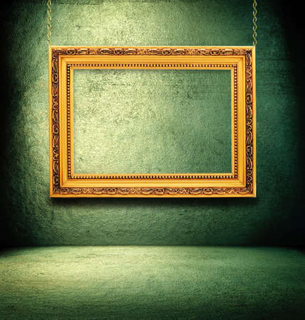 abandoned warehouse: Grunge green interior with golden frame. Stock Photo
