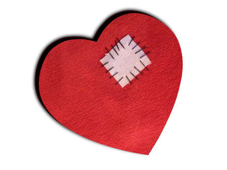 hearted: Love hurts - patched and mended broken heart - isolated on white
