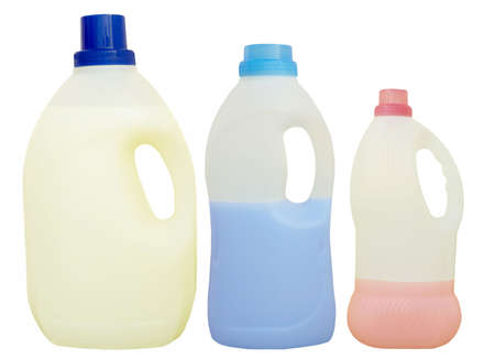 quantities: Plastic bottles with liquid contents. Isolated. Stock Photo