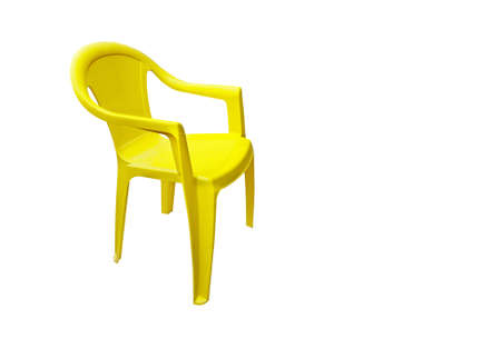 porch chair:  Bright yellow plastic chair - isolated Stock Photo