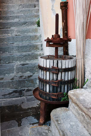 winepress: Traditional wine press in village setting
