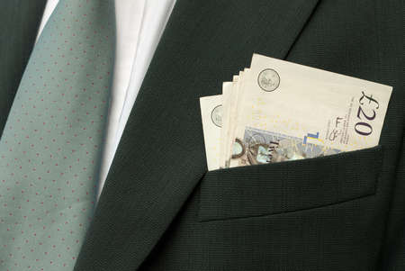 Cash in suit pocket - payment made! Stock Photo - 7757609