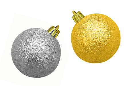 Glitzy gold and silver Christmas baubles - isolated on white