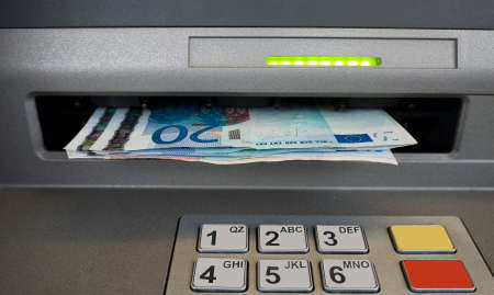 cashpoint: Cash dispenser - ATM - with Euros Stock Photo