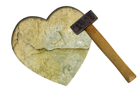 Stone heart with club hammer - unrequited love concept Stock Photo