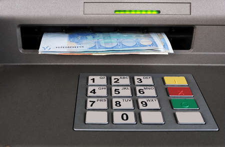 automatic teller machine: Cashpoint closeup with Euros