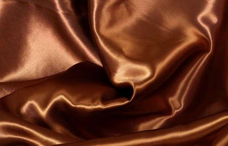 slinky: Brown satin fabric background