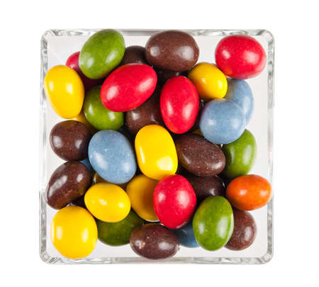 calorific: Bright sweets - candy - in square bowl, isolated Stock Photo