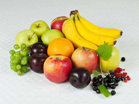 Assortment of fresh fruit on table cloth