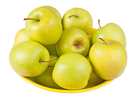 Bowl of Golden Delicious apples, isolated Imagens