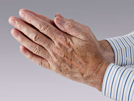 hands clasped: Hands in prayer  Stock Photo
