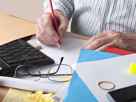 bureacracy: Man at busy, chaotic desk